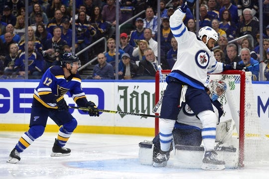 Apr 20, 2019; St. Louis, MO, USA; Winnipeg Jets defenseman Dustin Byfuglien (33) collides with goaltender Connor Hellebuyck (37) as St. Louis Blues left wing Jaden Schwartz (17) looks for the rebound during the first period in game six of the first round of the 2019 Stanley Cup Playoffs at Enterprise Center. Mandatory Credit: Jeff Curry-USA TODAY Sports