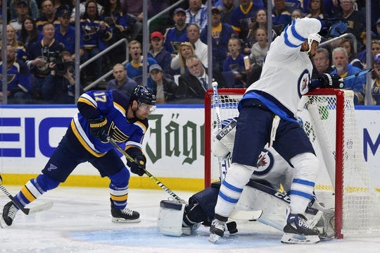 Apr 20, 2019; St. Louis, MO, USA; St. Louis Blues left wing Jaden Schwartz (17) grabs the rebound and scores against Winnipeg Jets goaltender Connor Hellebuyck (37) during the first period in game six of the first round of the 2019 Stanley Cup Playoffs at Enterprise Center. Mandatory Credit: Jeff Curry-USA TODAY Sports
