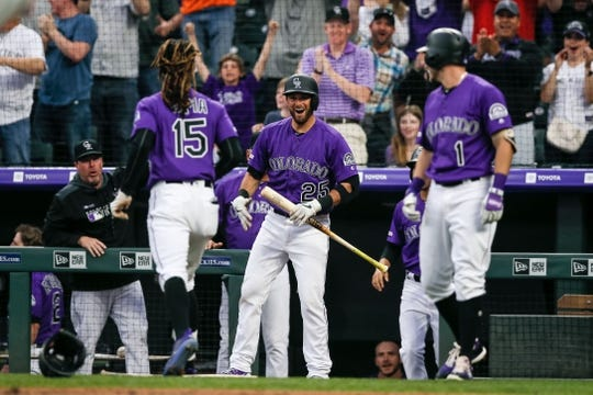 Apr 20, 2019; Denver, CO, USA; Colorado Rockies catcher Drew Butera (25) celebrates the inside the park home run of left fielder Raimel Tapia (15) in the second inning against the Philadelphia Phillies at Coors Field. Mandatory Credit: Isaiah J. Downing-USA TODAY Sports