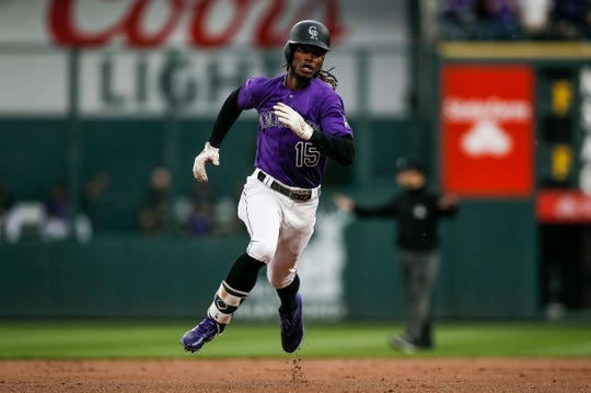 Apr 20, 2019; Denver, CO, USA; Colorado Rockies left fielder Raimel Tapia (15) rounds the bases on an inside the park home run in the second inning against the Philadelphia Phillies at Coors Field. Mandatory Credit: Isaiah J. Downing-USA TODAY Sports