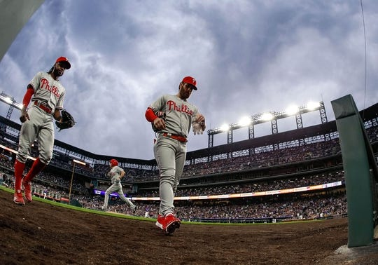 Apr 20, 2019; Denver, CO, USA; Philadelphia Phillies right fielder Bryce Harper (3) and center fielder Roman Quinn (24) come off the field at the end of the third inning against the Colorado Rockies at Coors Field. Mandatory Credit: Isaiah J. Downing-USA TODAY Sports
