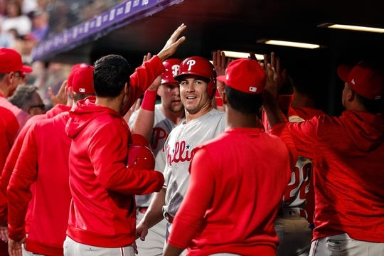 Apr 20, 2019; Denver, CO, USA; Philadelphia Phillies catcher J.T. Realmuto (10) and first baseman Rhys Hoskins (17) celebrate in the dugout after scoring on a play in the fourth inning against the Colorado Rockies at Coors Field. Mandatory Credit: Isaiah J. Downing-USA TODAY Sports