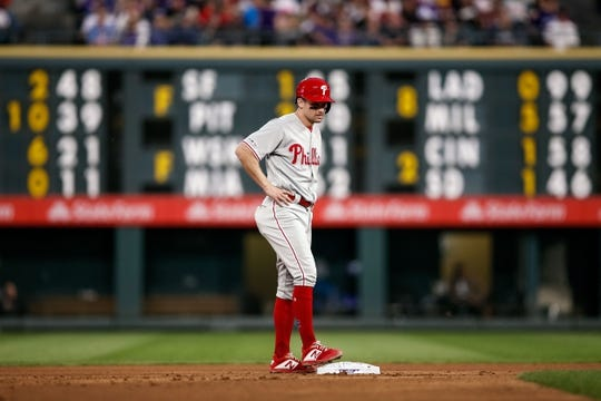 Apr 20, 2019; Denver, CO, USA; Philadelphia Phillies shortstop Phil Gosselin (9) on second after hitting a three RBI double in the fourth inning against the Colorado Rockies at Coors Field. Mandatory Credit: Isaiah J. Downing-USA TODAY Sports