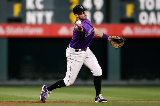 Apr 20, 2019; Denver, CO, USA; Colorado Rockies second baseman Garrett Hampson (1) fields and throws to first for an out in the fourth inning against the Philadelphia Phillies at Coors Field. Mandatory Credit: Isaiah J. Downing-USA TODAY Sports