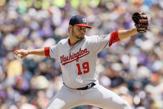 Apr 24, 2019; Denver, CO, USA; Washington Nationals starting pitcher Anibal Sanchez (19) pitches in the first inning against the Colorado Rockies at Coors Field. Mandatory Credit: Isaiah J. Downing-USA TODAY Sports