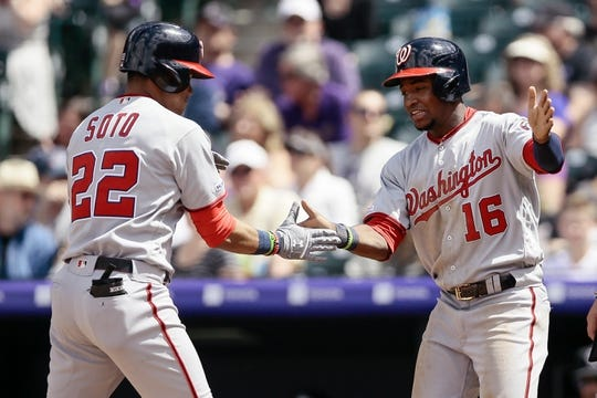 Apr 24, 2019; Denver, CO, USA; Washington Nationals left fielder Juan Soto (22) celebrates his two run home run with center fielder Victor Robles (16) in the third inning against the Colorado Rockies at Coors Field. Mandatory Credit: Isaiah J. Downing-USA TODAY Sports