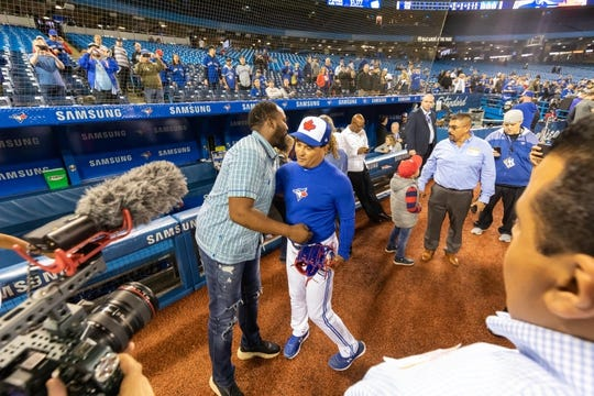 Apr 26, 2019; Toronto, Ontario, CAN; Toronto Blue Jays manager Charlie Montoyo (25) greets Vladimir Guerrero Sr. during batting practice prior to an MLB game against the Oakland Athletics at Rogers Centre. Mandatory Credit: Kevin Sousa-USA TODAY Sports