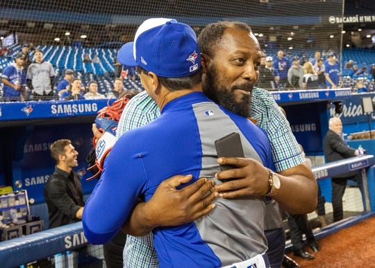 Apr 26, 2019; Toronto, Ontario, CAN; Toronto Blue Jays manager Charlie Montoyo (25) hugs Vladimir Guerrero Sr. during batting practice prior to an MLB game against the Oakland Athletics at Rogers Centre. Mandatory Credit: Kevin Sousa-USA TODAY Sports