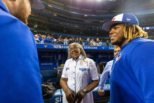 Apr 26, 2019; Toronto, Ontario, CAN; Toronto Blue Jays player Vladimir Guerrero Jr. introduces his grandmother Alta Gracia Alvino to teammate Rowdy Tellez (44) before playing the Oakland Athletics at Rogers Centre. Mandatory Credit: Kevin Sousa-USA TODAY Sports