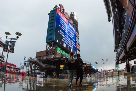 Apr 26, 2019; Philadelphia, PA, USA; Fans clear the outdoor section of Citizens Bank Park due to severe weather prior to a game between the Philadelphia Phillies and the Miami Marlins. Mandatory Credit: Bill Streicher-USA TODAY Sports