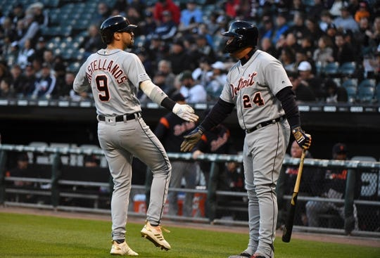 Apr 26, 2019; Chicago, IL, USA; Detroit Tigers right fielder Nicholas Castellanos (9) is congratulated by first baseman Miguel Cabrera (24) after hitting a home run against Chicago White Sox starting pitcher Carlos Rodon (not pictured) during the first inning at Guaranteed Rate Field. Mandatory Credit: Mike DiNovo-USA TODAY Sports