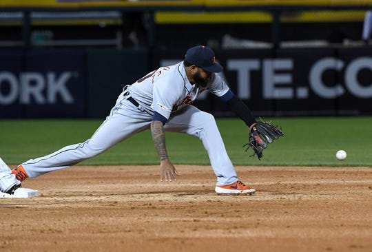 Apr 26, 2019; Chicago, IL, USA; Detroit Tigers third baseman Ronny Rodriguez (60) stretches for a force out against the Chicago White Sox during the second inning at Guaranteed Rate Field. Mandatory Credit: Mike DiNovo-USA TODAY Sports