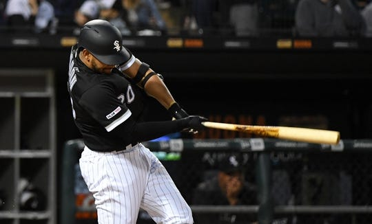 Apr 26, 2019; Chicago, IL, USA; Chicago White Sox shortstop Jose Rondon (20) hits a single against the Detroit Tigers during the second inning at Guaranteed Rate Field. Mandatory Credit: Mike DiNovo-USA TODAY Sports