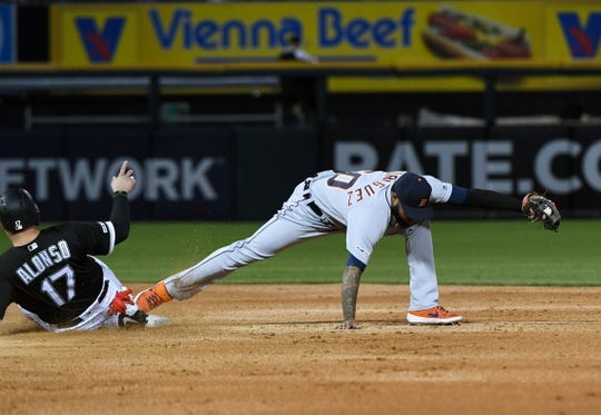 Apr 26, 2019; Chicago, IL, USA; Detroit Tigers third baseman Ronny Rodriguez (60) stretches for a force out against the Chicago White Sox first baseman Yonder Alonso (17) during the second inning at Guaranteed Rate Field. Mandatory Credit: Mike DiNovo-USA TODAY Sports