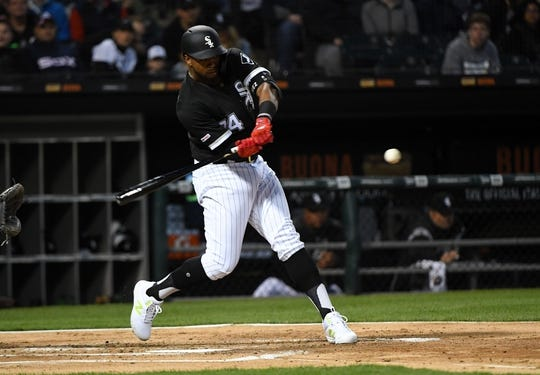 Apr 26, 2019; Chicago, IL, USA; Chicago White Sox left fielder Eloy Jimenez (74) hits a single against the Detroit Tigers during the second inning at Guaranteed Rate Field. Mandatory Credit: Mike DiNovo-USA TODAY Sports