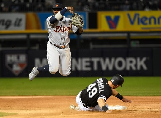 Apr 26, 2019; Chicago, IL, USA; Detroit Tigers second baseman Josh Harrison (1) makes a double play against Chicago White Sox center fielder Ryan Cordell (49) during the second inning at Guaranteed Rate Field. Mandatory Credit: Mike DiNovo-USA TODAY Sports