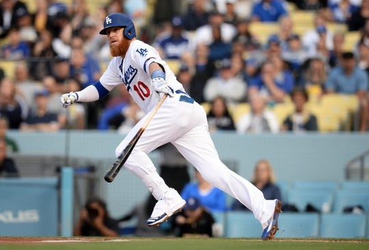 April 27, 2019; Los Angeles, CA, USA; Los Angeles Dodgers third baseman Justin Turner (10) reaches first on a fielders choice against the Pittsburgh Pirates during the first inning at Dodger Stadium. Mandatory Credit: Gary A. Vasquez-USA TODAY Sports