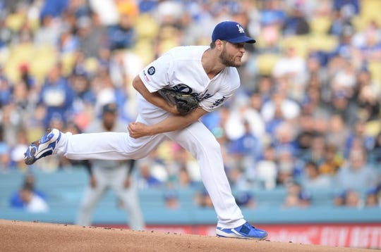 April 27, 2019; Los Angeles, CA, USA; Los Angeles Dodgers starting pitcher Clayton Kershaw (22) throws against the Pittsburgh Pirates during the first inning at Dodger Stadium. Mandatory Credit: Gary A. Vasquez-USA TODAY Sports