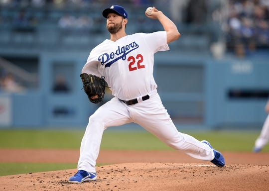 April 27, 2019; Los Angeles, CA, USA; Los Angeles Dodgers starting pitcher Clayton Kershaw (22) throws against the Pittsburgh Pirates during the second inning at Dodger Stadium. Mandatory Credit: Gary A. Vasquez-USA TODAY Sports