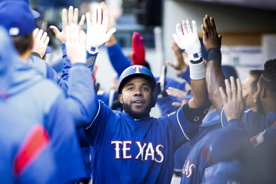 Apr 27, 2019; Seattle, WA, USA; Texas Rangers shortstop Elvis Andrus (1) gets high-fives from teammates after hitting a three-run home run against the Seattle Mariners during the first inning at T-Mobile Park. Mandatory Credit: Jennifer Buchanan-USA TODAY Sports