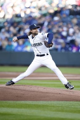 Apr 27, 2019; Seattle, WA, USA; Seattle Mariners starting pitcher Mike Leake (8) throws out a pitch against the Texas Rangers during the first inning at T-Mobile Park. Mandatory Credit: Jennifer Buchanan-USA TODAY Sports