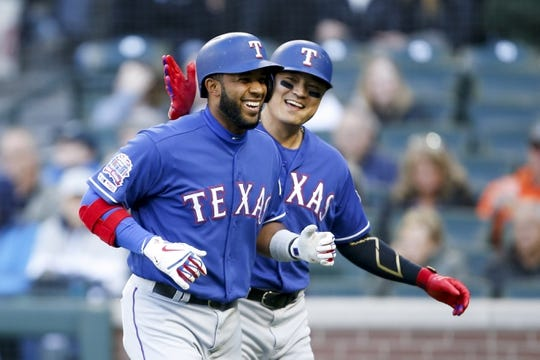 Apr 27, 2019; Seattle, WA, USA; Texas Rangers designated hitter Shin-Soo Choo (right) celebrates with shortstop Elvis Andrus (left) after Andrus hit a three-run home run against the Seattle Mariners during the first inning at T-Mobile Park. Mandatory Credit: Jennifer Buchanan-USA TODAY Sports