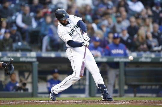 Apr 27, 2019; Seattle, WA, USA; Seattle Mariners left fielder Domingo Santana (16) hits a solo home run against the Texas Rangers during the first inning at T-Mobile Park. Mandatory Credit: Jennifer Buchanan-USA TODAY Sports