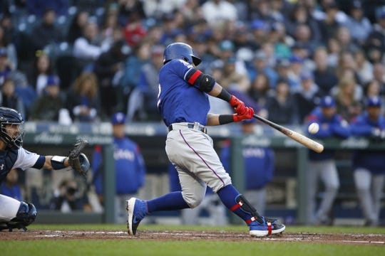 Apr 27, 2019; Seattle, WA, USA; Texas Rangers second baseman Rougned Odor (12) hits a three-run home run against the Seattle Mariners during the second inning at T-Mobile Park. Mandatory Credit: Jennifer Buchanan-USA TODAY Sports