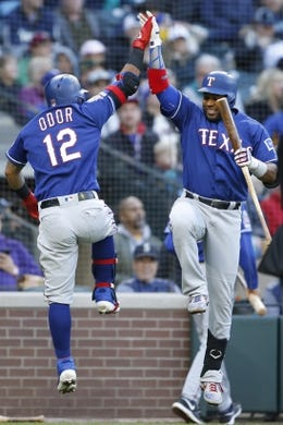 Apr 27, 2019; Seattle, WA, USA; Texas Rangers second baseman Rougned Odor (12) and shortstop Elvis Andrus (1) celebrate Odor's three-run home run against the Seattle Mariners during the second inning at T-Mobile Park. Mandatory Credit: Jennifer Buchanan-USA TODAY Sports