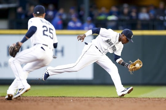 Apr 27, 2019; Seattle, WA, USA; Seattle Mariners shortstop Tim Beckham (1) gloves the ball but gets an error on the throw against the Texas Rangers during the third inning at T-Mobile Park. Mandatory Credit: Jennifer Buchanan-USA TODAY Sports