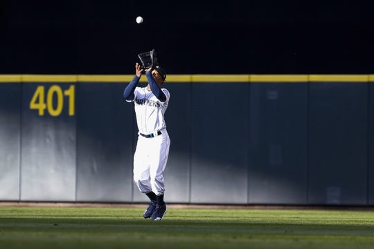 Apr 27, 2019; Seattle, WA, USA; Seattle Mariners center fielder Mallex Smith (0) makes a catch for an out against the Texas Rangers during the second inning at T-Mobile Park. Mandatory Credit: Jennifer Buchanan-USA TODAY Sports