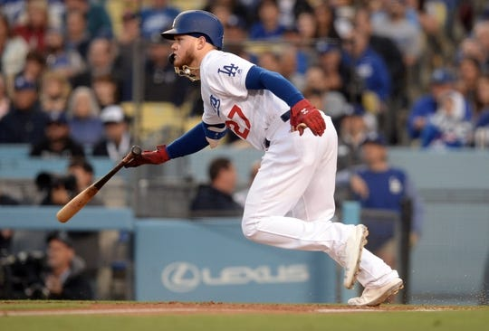April 27, 2019; Los Angeles, CA, USA; Los Angeles Dodgers center fielder Alex Verdugo (27) reaches first on a single against the Pittsburgh Pirates during the fourth inning at Dodger Stadium. Mandatory Credit: Gary A. Vasquez-USA TODAY Sports