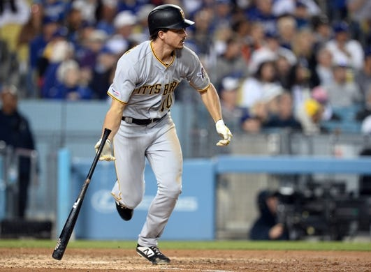 April 27, 2019; Los Angeles, CA, USA; Pittsburgh Pirates left fielder Bryan Reynolds (10) hits a double against the Los Angeles Dodgers during the seventh inning at Dodger Stadium. Mandatory Credit: Gary A. Vasquez-USA TODAY Sports