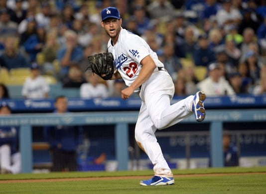 April 27, 2019; Los Angeles, CA, USA; Los Angeles Dodgers starting pitcher Clayton Kershaw (22) throws to first for the out against Pittsburgh Pirates third baseman Jung Ho Kang (16) during the sixth inning at Dodger Stadium. Mandatory Credit: Gary A. Vasquez-USA TODAY Sports