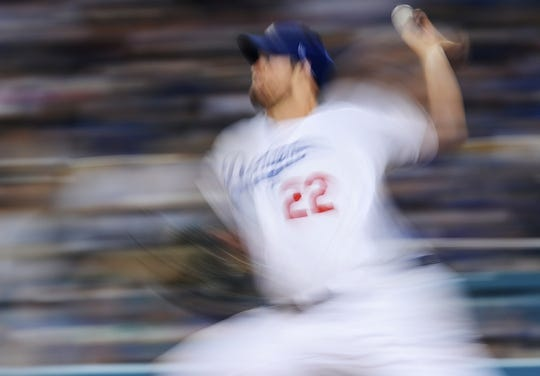 April 27, 2019; Los Angeles, CA, USA; Los Angeles Dodgers starting pitcher Clayton Kershaw (22) throws against the Pittsburgh Pirates during the seventh inning at Dodger Stadium. Mandatory Credit: Gary A. Vasquez-USA TODAY Sports