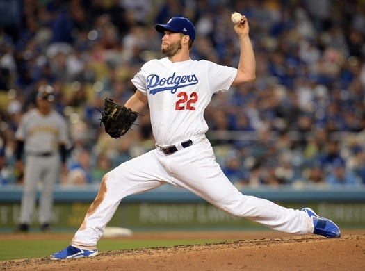 April 27, 2019; Los Angeles, CA, USA; Los Angeles Dodgers starting pitcher Clayton Kershaw (22) throws against the Pittsburgh Pirates during the sixth inning at Dodger Stadium. Mandatory Credit: Gary A. Vasquez-USA TODAY Sports