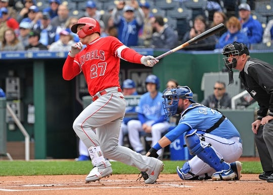 Apr 28, 2019; Kansas City, MO, USA; Los Angeles Angels center fielder Mike Trout (27) singles during the first inning against the Kansas City Royals at Kauffman Stadium. Mandatory Credit: Peter G. Aiken