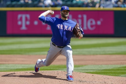 Apr 28, 2019; Seattle, WA, USA; Texas Rangers starting pitcher Lance Lynn (35) throws against the Seattle Mariners during the first inning at T-Mobile Park. Mandatory Credit: Joe Nicholson-USA TODAY Sports