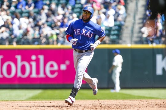 Apr 28, 2019; Seattle, WA, USA; Texas Rangers shortstop Elvis Andrus (1) runs the bases after hitting a two-run home run against the Seattle Mariners during the third inning at T-Mobile Park. Mandatory Credit: Joe Nicholson-USA TODAY Sports