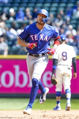 Apr 28, 2019; Seattle, WA, USA; Texas Rangers left fielder Hunter Pence (24) runs the bases after hitting a two-run home run against the Seattle Mariners during the third inning at T-Mobile Park. Mandatory Credit: Joe Nicholson-USA TODAY Sports