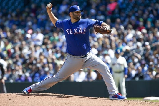 Apr 28, 2019; Seattle, WA, USA; Texas Rangers starting pitcher Lance Lynn (35) throws against the Seattle Mariners during the second inning at T-Mobile Park. Mandatory Credit: Joe Nicholson-USA TODAY Sports