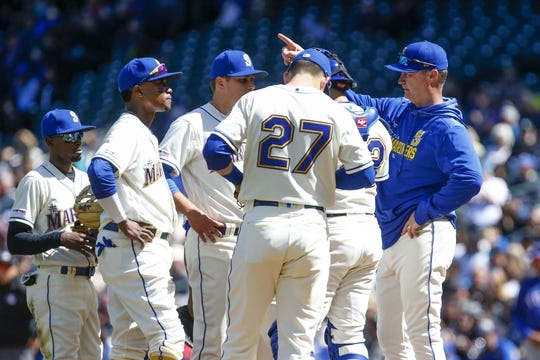 Apr 28, 2019; Seattle, WA, USA; Seattle Mariners manager Scott Servais (29) signals for a relief pitcher for starting pitcher Erik Swanson (third from left) during the fifth inning against the Texas Rangers at T-Mobile Park. Seattle Mariners second baseman Dee Gordon (left) and shortstop Tim Beckham (second from left) also stand on the mound. Mandatory Credit: Joe Nicholson-USA TODAY Sports