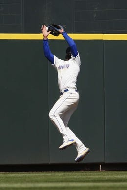 Apr 28, 2019; Seattle, WA, USA; Seattle Mariners right fielder Domingo Santana (16) fails to catch a fly ball against the Texas Rangers during the fifth inning at T-Mobile Park. Mandatory Credit: Joe Nicholson-USA TODAY Sports