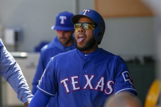 Apr 28, 2019; Seattle, WA, USA; Texas Rangers shortstop Elvis Andrus (1) reacts in the dugout after scoring a run against the Seattle Mariners during the fifth inning at T-Mobile Park. Mandatory Credit: Joe Nicholson-USA TODAY Sports