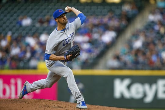 Apr 30, 2019; Seattle, WA, USA; Chicago Cubs starting pitcher Cole Hamels (35) throws against the Seattle Mariners during the first inning at T-Mobile Park. Mandatory Credit: Joe Nicholson-USA TODAY Sports