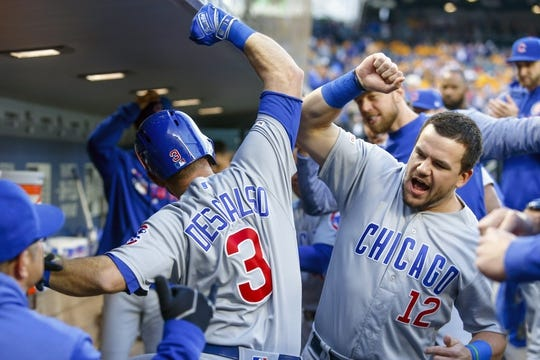 Apr 30, 2019; Seattle, WA, USA; Chicago Cubs left fielder Kyle Schwarber (12) congratulates second baseman Daniel Descalso (3) following his solo-home run against the Seattle Mariners during the first inning at T-Mobile Park. Mandatory Credit: Joe Nicholson-USA TODAY Sports