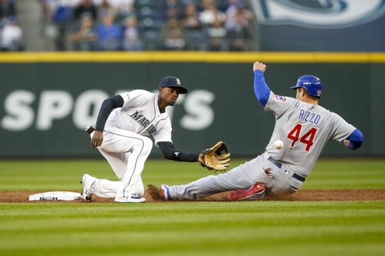 Apr 30, 2019; Seattle, WA, USA; Chicago Cubs first baseman Anthony Rizzo (44) steals a base before Seattle Mariners second baseman Dee Gordon (9) can apply a tag during the third inning at T-Mobile Park. Mandatory Credit: Joe Nicholson-USA TODAY Sports