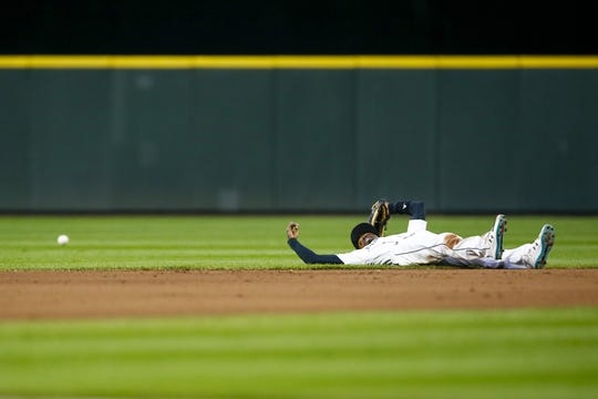Apr 30, 2019; Seattle, WA, USA; Seattle Mariners second baseman Dee Gordon (9) reacts after failing to field a ground ball during the fourth inning at T-Mobile Park. Mandatory Credit: Joe Nicholson-USA TODAY Sports