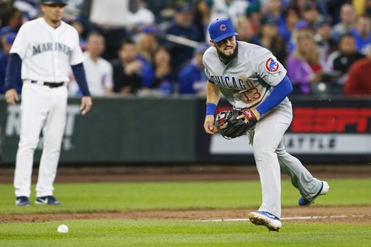 Apr 30, 2019; Seattle, WA, USA; Chicago Cubs third baseman David Bote (13) commits an error while attempting to field a ground ball against the Seattle Mariners during the fourth inning at T-Mobile Park. Mandatory Credit: Joe Nicholson-USA TODAY Sports