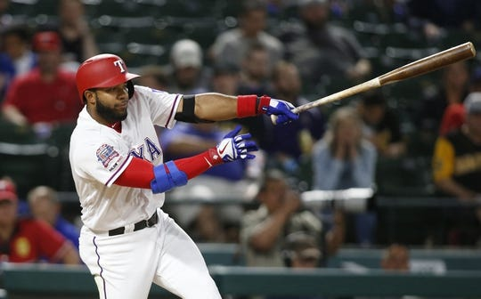 Apr 30, 2019; Arlington, TX, USA; Texas Rangers shortstop Elvis Andrus (1) hits a single in the fourth inning against the Pittsburgh Pirates at Globe Life Park in Arlington. Mandatory Credit: Tim Heitman-USA TODAY Sports